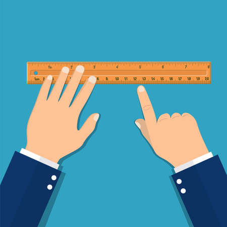 Plastic measuring ruler in hand.