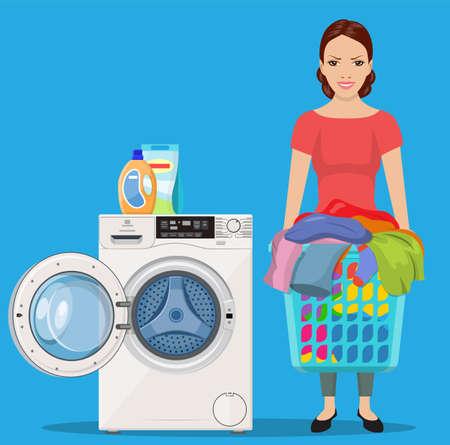 Cheerful girl standing and holding laundry basket near washing machine