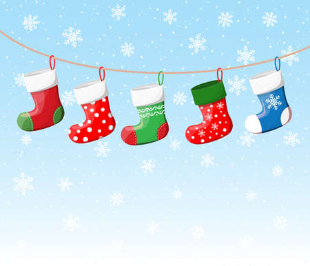 Christmas stockings in various colors on rope Stock Photo