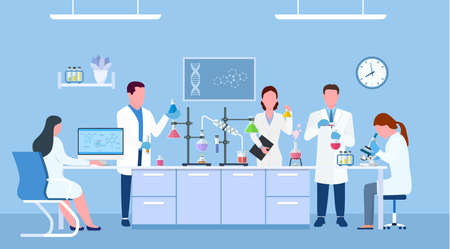 . Scienziati che indossano camici da laboratorio