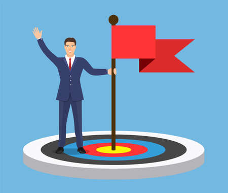 Businessman with flag standing on a target