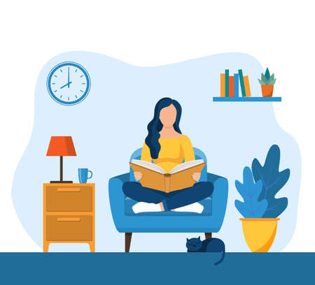 Young woman reading book on chair at home