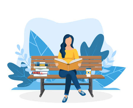 Young woman reading book on the bench.
