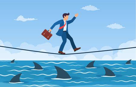 Businessman walking a tightrope over shark