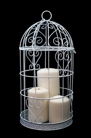 coop: Candlestick with three candle, cage style, Valentines Day decor. Isolated on black background. Stock Photo