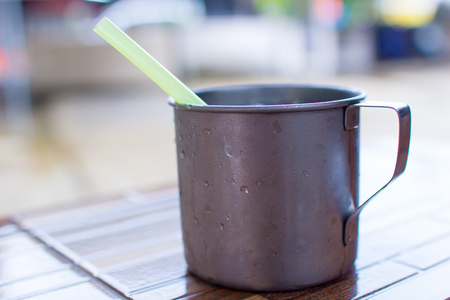 Stainless cup of cold water with ice is Asia style Stock Photo