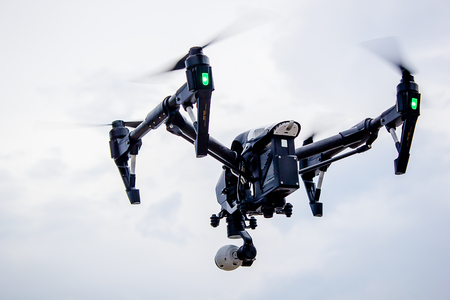 Professional camera drone flying Stock Photo