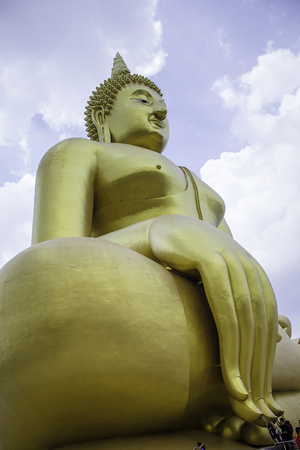 The big golden Buddha statue in Muang temple, Ang Thong, Thailand. Stock Photo