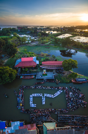 mournful: On Dec 4,2016. The people of Phak-Hai, Ayutthaya, Thailand. Gather for a dedication ceremony of mourning the death of His Majesty the King Bhumibol Adulyadej. People card stunts by boat on river. Mean 9 Thai number. Editorial