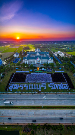 mournful: On Nov 25,2016. The people of Suphanburi, Thailand. Gather for a dedication ceremony of mourning the death of His Majesty the King Bhumibol Adulyadej. People card stunts. Mean People of Suphanburi love the King Bhumibol Adulyadej.