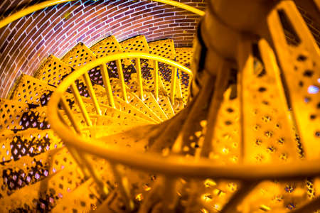 Spiral stairs that lead the way to the top of the lighthouse. Upper view. Stock Photo
