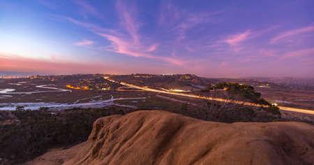 A long exposure at sundown of the 5 freeway near a protected habitat. Stock Photo