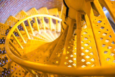 ample: Spiral staircase bright yellow and ample blur and copy space Editorial