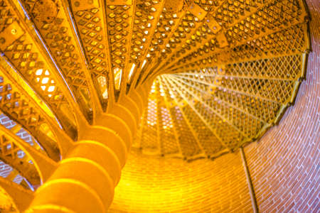 ample: Spiral staircase bright yellow and ample blur and copy space Stock Photo