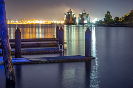 Ruston Park Boats from the docks in Washington state USA. The bay in Tacoma Washington at sunset and into nightfall