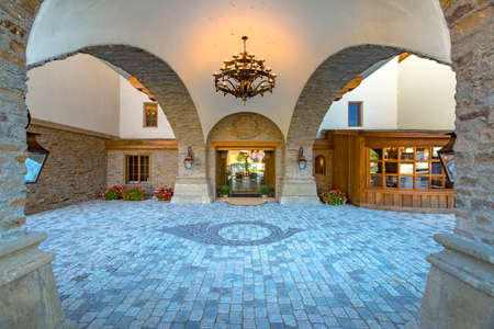 chandelier background: Stone entrance of the Waterfront Hotel . Beautiful views of the small town of Leavenworth