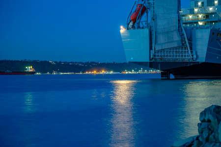 Ruston Park Boats and view in Washington state USA. The bay in Tacoma Washington at sunset and into nightfall Stock Photo