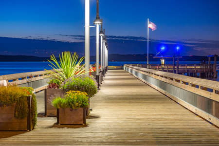 Rustic pier in Tacoma . The bay in Tacoma Washington at sunset and into nightfall Stock Photo