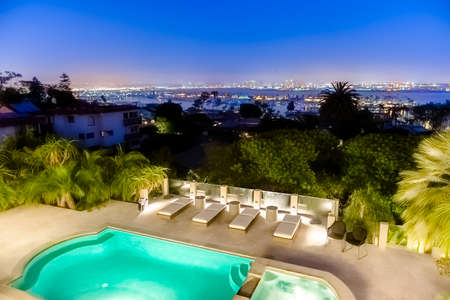 Home in San Diego county in a luxury backyard with pool in Point Loma and a view in of downtown San Diego. Wonderful California home in San Diego county. Real estate listings with powerful visuals.  Editorial