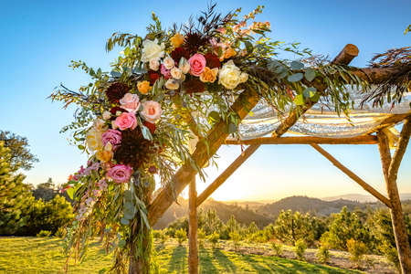 Jewish traditions wedding ceremony. Wedding canopy chuppah or huppah close up on the flowers Stock Photo