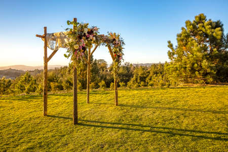Jewish traditions wedding ceremony. Wedding canopy chuppah or huppah during golden hour