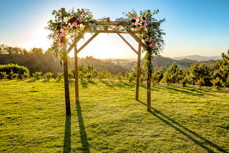 Jewish traditions wedding ceremony. Wedding canopy chuppah or huppah with the sun behind it Stock Photo