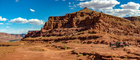 Canyon vies in Moab, Utah seen from the view of off-roading vehicles. white puffy clouds Stock Photo