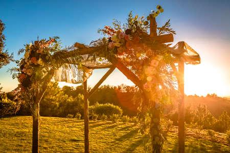 Jewish traditions wedding ceremony. Wedding canopy chuppah or huppah with lens flare Stock Photo