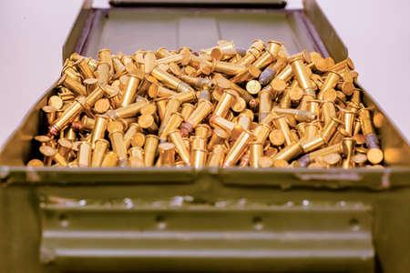 Green ammo box full of bullets