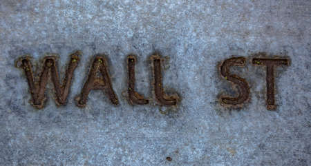 Engraved Wall Street lettering on concrete