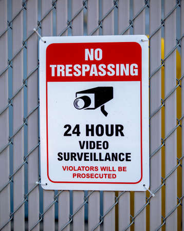 No trespassing sign with 24 hour video Stock Photo