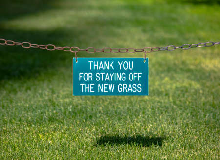 Thank you for staying off the new grass sign Imagens
