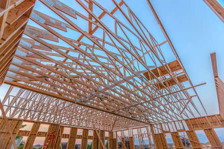 Looking up at new roof wood beams