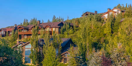 Luxury homes with sunset lighting Park City pano