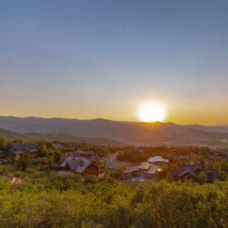 Luxury neighborhood in the Park City hillside forests of the mountain climate with wonderful views of the valley and other mountains in the background. Sunset views in summer 2018.