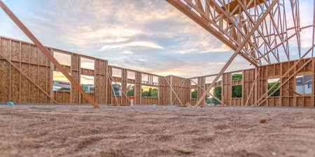 Wooden beams in sand area in building wide pano 스톡 콘텐츠
