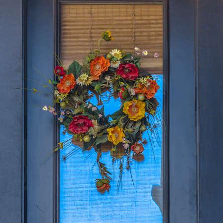 Decorative flower wreath hanging on a door