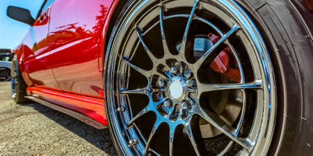 Polished rim of a bright red car