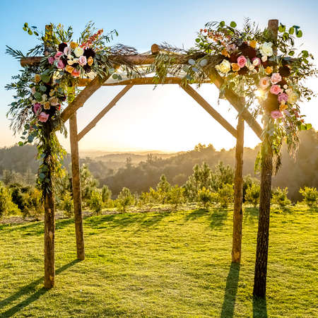 Chuppah with flowers on a Jewish wedding Фото со стока