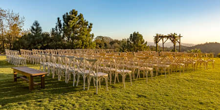 Chairs and Chuppah on a lawn with stunning view