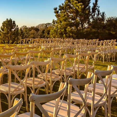 White chairs on lawn for a sunny outdoor wedding Stock Photo - 108834948