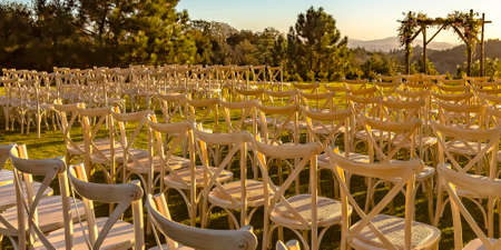 Rows and columns of chairs facing a Chuppah Stock Photo - 108835024