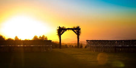 Chuppah silhouetted by the golden setting sun Stock Photo - 110749895