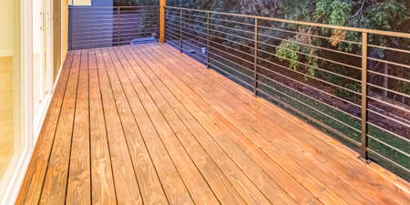 Balcony with wooden floor and glass door access Фото со стока
