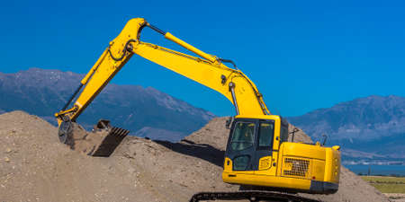 Diggers picking up dirt in Eagle Mountain Utah
