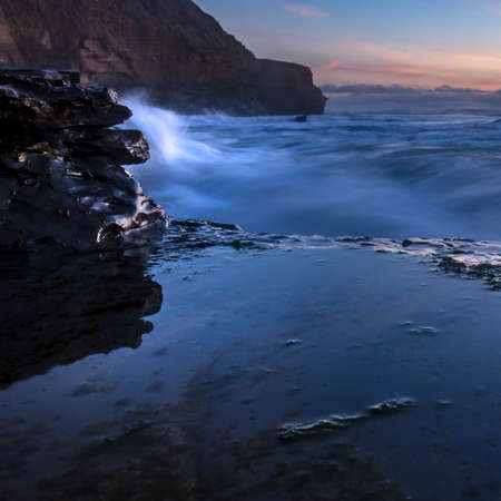 Tide pools and cliff in San Diego CA at sunset