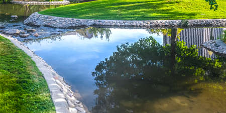 City Creek Park with reflections on clear water Imagens