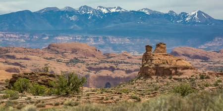 View of rocky terrain and La Sal Mountain in Moab