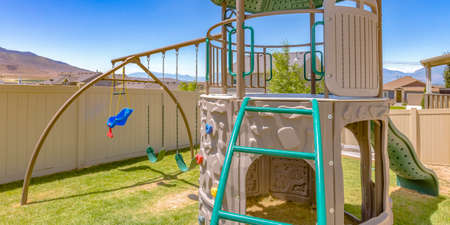 Playground on a sunny backyard of a home Stock fotó