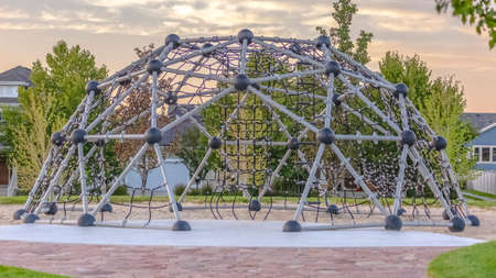 Dome climbing frame in Daybreak Utah neighborhood Stock Photo
